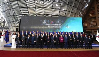 European Union leaders and their Asian counterparts pose for a group photo during an EU-ASEM summit in Brussels, Friday, Oct. 19, 2018. EU leaders met with their Asian counterparts Friday to discuss trade, among other issues. (AP Photo/Alastair Grant)
