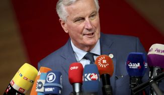 """European Union chief Brexit negotiator Michel Barnier speaks with the media as he arrives for an EU summit in Brussels, Wednesday, Oct. 17, 2018. European Union leaders are converging on Brussels for what had been billed as a """"moment of truth"""" Brexit summit but which now holds little promise for a breakthrough. (AP Photo/Francisco Seco)"""