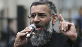 FILE - This is a Friday, April 3, 2015 file photo of Anjem Choudary, a British Muslim social and political activist and spokesman for Islamist group, Islam4UK, speaks following prayers at the Central London Mosque in Regent's Park, London. Anjem Choudary, a radical preacher convicted of inviting support for the Islamic State group, has been released from Belmarsh prison in southeast London on Friday Oct. 19, 2018. (AP Photo/Tim Ireland, File)
