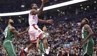 Toronto Raptors forward Kawhi Leonard (2) scores on the Boston Celtics during the second half of an NBA basketball game in Toronto on Friday, Oct. 19, 2018. (Frank Gunn/The Canadian Press via AP)