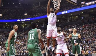Toronto Raptors forward Kawhi Leonard (2) dunks against the Boston Celtics during second-half NBA basketball game action in Toronto, Friday, Oct. 19, 2018. (Frank Gunn/The Canadian Press via AP)