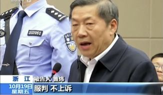 "In this image taken from video, Lu Wei, former minister of China's Cyberspace Administration, speaks during his trial in the city of Ningbo in eastern China's Zhejiang province, Friday, Oct. 19, 2018. China's former internet censor, who once held high-profile meetings with industry leaders such as Apple chief executive Tim Cook and Facebook founder Mark Zuckerberg, stood trial on Friday on corruption allegations. Chinese headlines at the bottom reads: ""Obey sentencing, Will not appeal."" (CCTV via AP)"