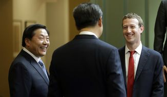 In this Sept. 23, 2015, photo, Chinese President Xi Jinping, center, talks with Facebook Chief Executive Mark Zuckerberg, right, as Lu Wei, left, China's Internet czar, looks on during a gathering of CEOs and other executives at Microsoft's main campus in Redmond, Wash. Lu was standing trial Friday, Oct. 19, 2018, on corruption allegations, state media reported. (AP Photo/Ted S. Warren, Pool) **FILE**