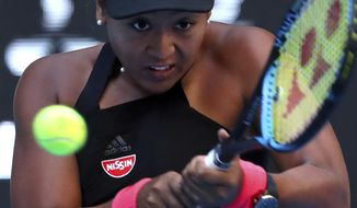Naomi Osaka of Japan hits a return shot while competing against Anastasija Sevastova of Latvia in their women's singles semifinal match in the China Open at the National Tennis Center in Beijing, Saturday, Oct. 6, 2018. (AP Photo/Mark Schiefelbein)
