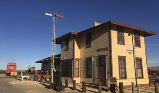 In this Oct. 3, 2018 photo, the historic train station of Columbus, N.M., once attacked by Mexican Revolutionary Pancho Villa is shown before sunset. As Democrats seek to flip a key GOP U.S. House seat in southern New Mexico, the path to victory in districts like those that encompass Columbus includes winning over fiercely independent voters in communities who have their own views about border life. (AP Photo/Russell Contreras)