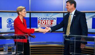 Massachusetts Senate candidates Sen. Elizabeth Warren, left, and her opponent State Rep. Geoff Diehl shake hands before a debate in Boston, Friday, Oct. 19, 2018. (AP Photo/Michael Dwyer)