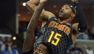 Atlanta Hawks guard Vince Carter (15) shoots against Memphis Grizzlies forward JaMychal Green (0) in the first half of an NBA basketball game Friday, Oct. 19, 2018, in Memphis, Tenn. (AP Photo/Brandon Dill)
