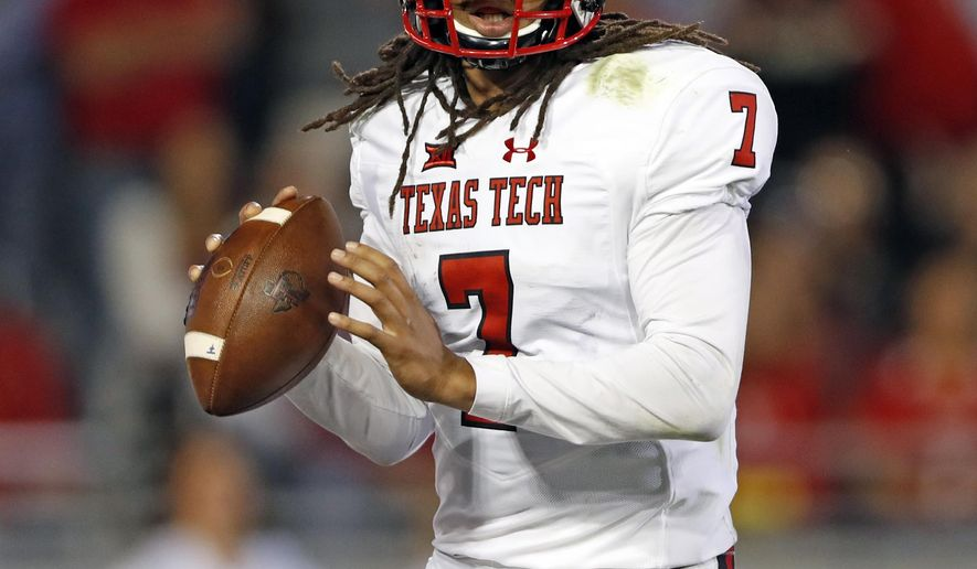 FILE - In this Oct. 11, 2018, file photo, Texas Tech's Jett Duffey (7) looks for a receiver during the first half of an NCAA college football game against TCU, in Fort Worth, Texas. Kansas plays at texas tech on Saturday, Oct. 20. (Brad Tollefson/Lubbock Avalanche-Journal via AP, File)