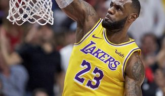 Los Angeles Lakers forward LeBron James dunks against the Portland Trail Blazers during the first half of an NBA basketball game in Portland, Ore., Thursday, Oct. 18, 2018. (AP Photo/Craig Mitchelldyer)