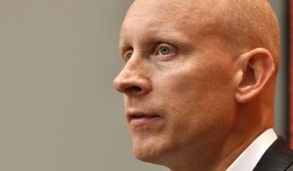 Louisville NCAA college basketball head coach Chris Mack listens to a reporter's question during the team's media day in Louisville, Ky., Friday, Oct. 19, 2018. (AP Photo/Timothy D. Easley)