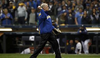Former Commissioner of Baseball Bud Selig throws a ceremonial first pitch before Game 6 of the National League Championship Series baseball game between the Milwaukee Brewers and the Los Angeles Dodgers Friday, Oct. 19, 2018, in Milwaukee. (AP Photo/Jeff Roberson)