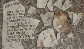 Fragments of a plaque lie on the floor of a former hospital that is being transformed into a museum on the history of the Warsaw ghetto during the German occupation of Poland, in Warsaw, Poland, on Friday Oct. 19, 2018. The plaque listed the names of donors of the original hospital, the Bersohn and Bauman Children's Hospital, which was established in the late 19th century by Jewish philanthopists. The museum is scheduled to open in 2023. (AP Photo/Vanessa Gera)