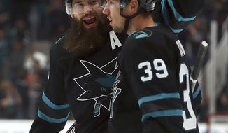 San Jose Sharks' Logan Couture (39) celebrates with Brent Burns, left, after scoring a goal against the Buffalo Sabres during the first period of an NHL hockey game Thursday, Oct. 18, 2018, in San Jose, Calif. (AP Photo/Ben Margot)