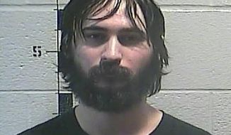 This is a photo released by the Shelby County Detention Center in Shelbyville Ky., shows Dylan Jarrell, who has been charged with harassing communications and terroristic threatening in relation to a threat against schools in Shelby and Anderson counties. Jarrell, 20, was arrested Thursday evening, Oct. 18, 2018, and authorities found a firearm, more than 200 rounds of ammunition, a bulletproof vest, a 100-round high capacity magazine and a detailed plan of attack in his possession, state police said.  (Shelby County Detention Center via AP)