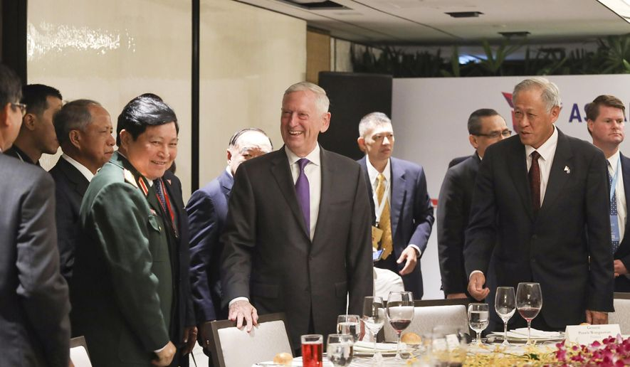 U.S. Defense Secretary Jim Mattis, center, and Singapore's Defense Minister Ng Eng Hen, front right,  attend an informal lunch meeting with defense ministers at ASEAN Defense Ministers' Meeting in Singapore Friday, Oct. 19, 2018. (AP Photo/Don Wong)
