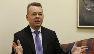 In this file photo, Pastor Andrew Brunson speaks during an interview at the headquarters of Christian Broadcasting Network in Virginia Beach, Va., Friday, Oct. 19, 2018. (AP Photo/Steve Helber) **FILE**