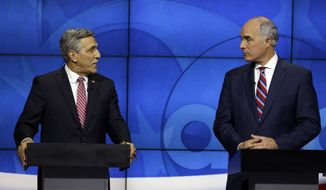 U.S. Sen.Bob Casey, D-PA, right, listens to Republican challenger U.S. Rep. Lou Barletta, during their first debate, Saturday Oct. 20, 2018, in the studio of WPVI-TV in Philadelphia. Casey, 58, of Scranton, is seeking a third six-year term. Barletta, 62, of Hazleton, is in his fourth term in Congress. (AP Photo/Jacqueline Larma)