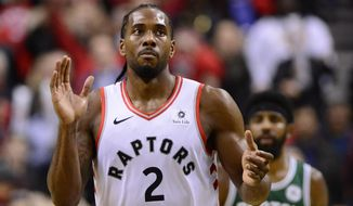 Toronto Raptors forward Kawhi Leonard (2) celebrate defeating the Boston Celtics in an NBA basketball game in Toronto on Friday, Oct. 19, 2018. The Raptors won, 113-101. (Frank Gunn/The Canadian Press via AP)