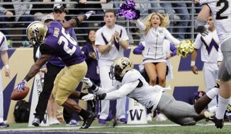 Washington running back Salvon Ahmed, left, scores a touchdown ahead of Colorado linebacker Davion Taylor during the first half of an NCAA college football game, Saturday, Oct. 20, 2018, in Seattle. (AP Photo/Ted S. Warren)