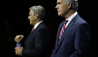 U.S. Sen.Bob Casey, D-PA, right, and Republican challenger U.S. Rep. Lou Barletta prepare before their first debate, Saturday Oct. 20, 2018, in the studio of WPVI-TV in Philadelphia. Casey, 58, of Scranton, is seeking a third six-year term. Barletta, 62, of Hazleton, is in his fourth term in Congress. (AP Photo/Jacqueline Larma)