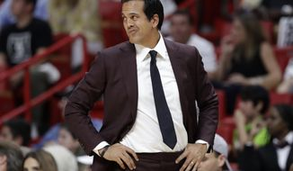 Miami Heat head coach Erik Spoelstra watches the first half of an NBA basketball game against the Charlotte Hornets, Saturday, Oct. 20, 2018, in Miami. (AP Photo/Lynne Sladky)