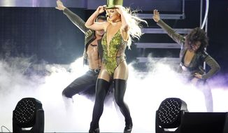 FILE- In this June 13, 2017, file photo, singer Britney Spears sings during her concert in Taipei, Taiwan. MGM Resorts International on Friday said the pop superstar in February, 2019, will kick off a series of regularly scheduled shows at Park Theater inside the Park MGM casino-resort on the Las Vegas Strip. (AP Photo/Chiang Ying-ying, file)