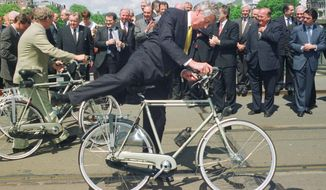 In this Tuesday June 17, 1997 file image Dutch Prime Minister Wim Kok gets on his bicycle, applauded by European Prime Ministers, background, after European leaders were presented with Dutch bikes by the city of Amsterdam at te occasion of a two-day European Union summit to salvage plans for a single currency and the expansion of the EU. Current Dutch prime minister Mark Rutte said that former premier Wim Kok, a trade unionist-turned-politician who inspired a new breed of pragmatic Social Democratic leaders in Europe, has died at age 80. (AP Photo/Hermann Knippertz)