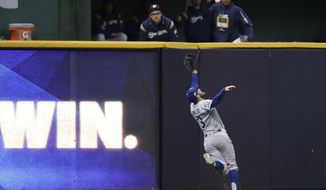 Los Angeles Dodgers center fielder Chris Taylor (3) catch the fly ball hit by Milwaukee Brewers' Christian Yelich during the fifth inning of Game 7 of the National League Championship Series baseball game Saturday, Oct. 20, 2018, in Milwaukee. (AP Photo/Jeff Roberson)
