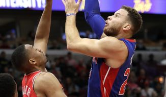 Detroit Pistons forward Blake Griffin, right, shoots against Chicago Bulls forward Jabari Parker during the first half of an NBA basketball game Saturday, Oct. 20, 2018, in Chicago. (AP Photo/Nam Y. Huh)