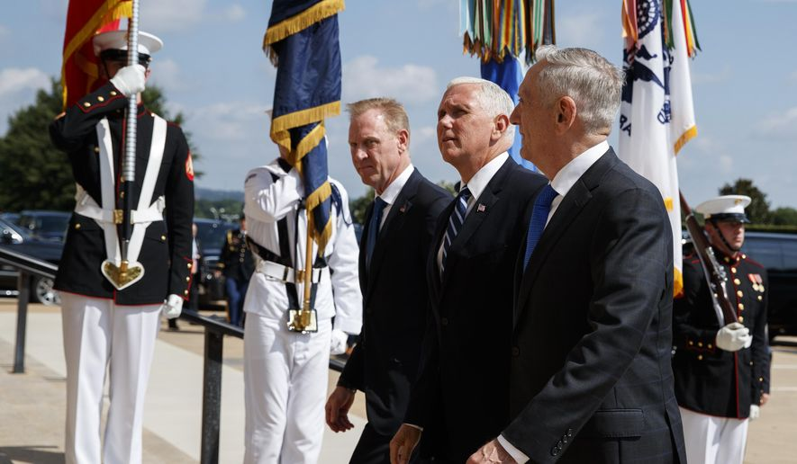 In this Aug. 9, 2018, file photo, Vice President Mike Pence, center, is greeted by Deputy Secretary of Defense Pat Shanahan, left, and Secretary of Defense Jim Mattis before speaking at an event on the creation of a United States Space Force at the Pentagon. (AP Photo/Evan Vucci)