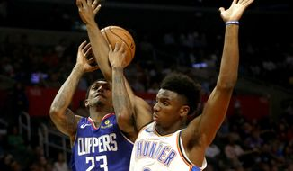 Los Angeles Clippers' Lou Williams (23) gets fouled by Oklahoma City Thunder's Hamidou Diallo (6) during the first half of an NBA basketball game Friday, Oct. 19, 2018, in Los Angeles. (AP Photo/Ringo H.W. Chiu)
