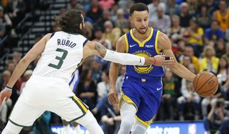 Golden State Warriors guard Stephen Curry, right, drives around Utah Jazz guard Ricky Rubio (3) in the first half during an NBA basketball game Friday, Oct. 19, 2018, in Salt Lake City. (AP Photo/Rick Bowmer)