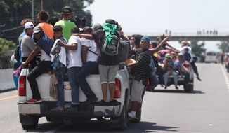 Central American migrants overwhelmed authorities at the Mexican border and prepared for the long journey across the country toward the U.S., where they plan to test the Trump administration's resolve. (Associated Press)