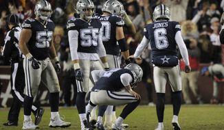 Dallas Cowboys kicker Brett Maher (2) reacts after missing a field goal in the closing seconds of an NFL football game against the Washington Redskins, Sunday, Oct. 21, 2018 in Landover, Md. (AP Photo/Mark Tenally)