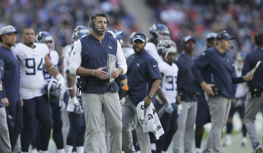 Tennessee Titans head coach Mike Vrabel stands on the touchline during the first half of an NFL football game against Los Angeles Chargers at Wembley stadium in London, Sunday, Oct. 21, 2018. (AP Photo/Tim Ireland) **FILE**