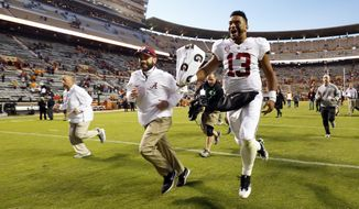 Alabama quarterback Tua Tagovailoa (13) celebrates as he leaves the field after an NCAA college football game against Tennessee Saturday, Oct. 20, 2018, in Knoxville, Tenn. Alabama won 58-21. (AP Photo/Wade Payne)