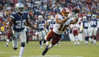 Washington Redskins wide receiver Josh Doctson (18) reaches for an incomplete pass as Dallas Cowboys cornerback Anthony Brown (30) looks on during the first half of an NFL football game, Sunday, Oct. 21, 2018, in Landover, Md. (AP Photo/Andrew Harnik) ** FILE **