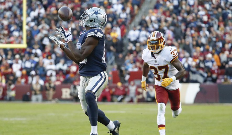 Dallas Cowboys wide receiver Michael Gallup (13) pulls in a touchdown pass as Washington Redskins defensive back Greg Stroman (37) pursues during the first half of an NFL football game, Sunday, Oct. 21, 2018 in Landover, Md. (AP Photo/Andrew Harnik) **FILE**