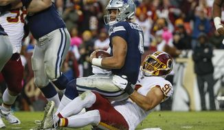 Washington Redskins linebacker Ryan Kerrigan (91) sacks Dallas Cowboys quarterback Dak Prescott (4) during the second half of an NFL football game, Sunday, Oct. 21, 2018 in Landover, Md. (AP Photo/Alex Brandon)