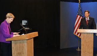 Democratic U.S. Sen. Elizabeth Warren, left, and Republican challenger state Rep. Geoff Diehl participate in a U.S. Senate debate, Sunday, Oct. 21, 2018, in Springfield, Mass. (Frederick Gore/The Republican via AP)