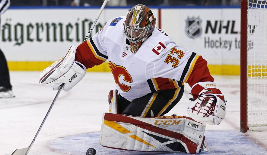 Calgary Flames goaltender David Rittich (33) makes a save against the New York Rangers in the second period of an NHL hockey game Sunday, Oct. 21, 2018, in New York. (AP Photo/Adam Hunger)