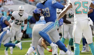 Detroit Lions running back LeGarrette Blount (29) runs for a touchdown, during the first half of an NFL football game against the Miami Dolphins, Sunday, Oct. 21, 2018, in Miami Gardens, Fla. (AP Photo/Lynne Sladky)