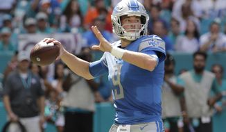 Detroit Lions quarterback Matthew Stafford (9) looks to pass, during the first half of an NFL football game against the Miami Dolphins, Sunday, Oct. 21, 2018, in Miami Gardens, Fla. (AP Photo/Lynne Sladky)