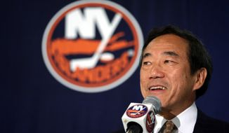 FILE - In this June 8, 2006, file photo, New York Islanders owner Charles Wang addresses members of the media during a news conference, in Uniondale, N.Y. Wang, a technology company founder who formerly owned the New York Islanders hockey team has died. He was 74. His attorney John McEntee says in an emailed statement that Wang died Sunday, Oct. 21, 2018, in Oyster Bay, N.Y. (AP Photo/Mary Altaffer, File)