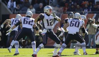New England Patriots quarterback Tom Brady (12) throws during the first half of an NFL football game against the Chicago Bears Sunday, Oct. 21, 2018, in Chicago. (AP Photo/Nam Y. Huh)