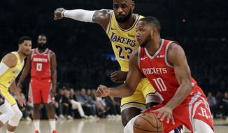 Los Angeles Lakers' LeBron James (23) defends on Houston Rockets' Eric Gordon (10) during the first half of an NBA basketball game Saturday, Oct. 20, 2018, in Los Angeles. (AP Photo/Marcio Jose Sanchez)