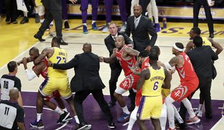Houston Rockets' Chris Paul, far left, is held back by Los Angeles Lakers' LeBron James, second from left, after Paul fought with Lakers' Rajon Rondo, far right, during the second half of an NBA basketball game Saturday, Oct. 20, 2018, in Los Angeles. The Rockets won, 124-115. (AP Photo/Marcio Jose Sanchez) **FILE**
