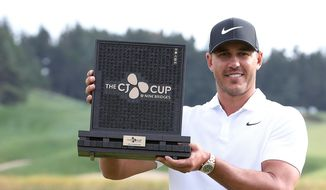 Brooks Koepka of the United States poses with his trophy after winning the CJ Cup PGA golf tournament at Nine Bridges on Jeju Island, South Korea, Sunday, Oct. 21, 2018. (Park Ji-ho/Yonhap via AP)