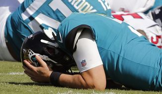 Jacksonville Jaguars quarterback Blake Bortles reacts after losing a fumble to the Houston Texans during the second half of an NFL football game, Sunday, Oct. 21, 2018, in Jacksonville, Fla. (AP Photo/Stephen B. Morton)