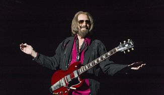 FILE - In a Sunday, Sept. 17, 2017 file photo, Tom Petty and the Heartbreakers perform at KAABOO 2017 at the Del Mar Racetrack and Fairgrounds, in San Diego, Calif. Hundreds of members of the Tom Petty Nation! fan club visited Gainesville Saturday, Oct. 20, 2018 to celebrate the star's birthday with his music and the dedication of the former Northeast Park as Tom Petty Park. (Photo by Amy Harris/Invision/AP, File)